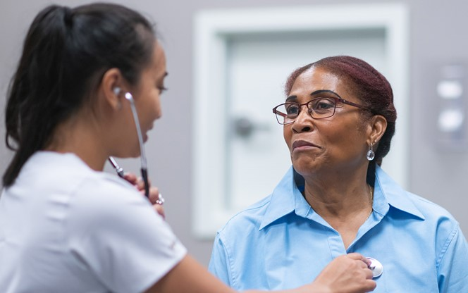 Senior Adult Woman In Consultation With Female Doctor