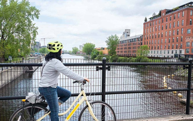 Cyclist Enjoying View Of Lachine Canal